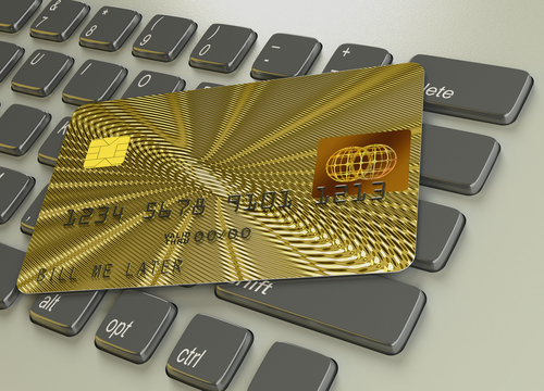 Golden credit card on keyboard