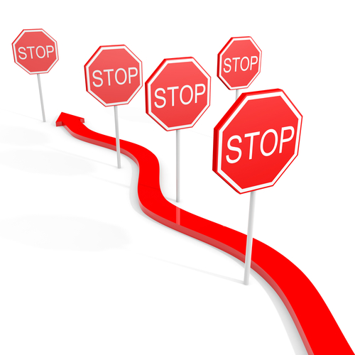 Long red arrow with stop signs all along